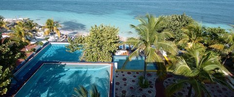 Outdoor swimming pool Maya Caribe Beach House Hotel